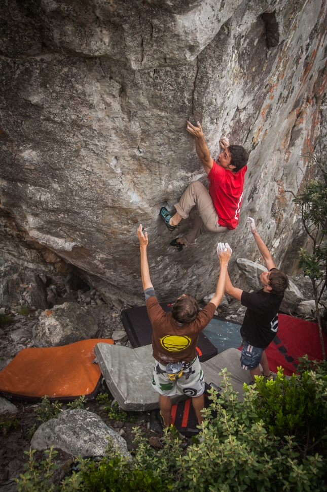 Working my way up Lonely Boy (7B+) with the spotting arms of Sheldon and Sqeaky. Photo by Jono Joseph.